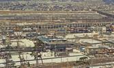 昭和44年(1969年)3月5日に、多摩ニュータウン開発を千葉県北総開発局白井用地事務所一行が視察した時に撮影されたもの。桜ケ丘から北方向を写しており、遠景に見える川は多摩川。京王線は高架化工事中で、撮影時点はまだ地上を走っていた。