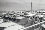 福生市役所から福生駅方面を写した風景です。高い煙突は銭湯「松の湯」ですが、現在はなくなってしまいました。